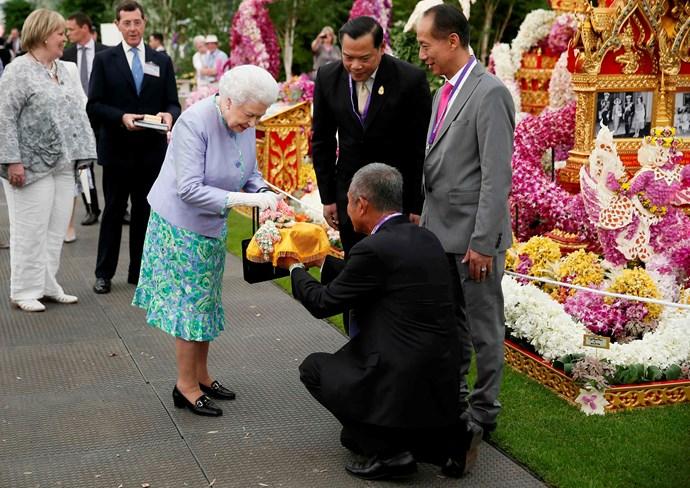 Queen Elizabeth visits the Thai exhibit at the Chelsea Flower Show.
