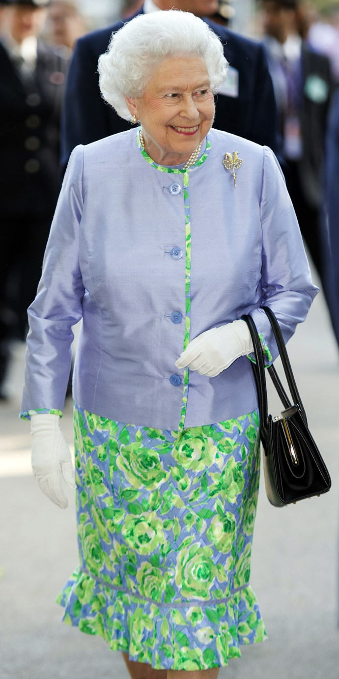 The Queen looked lovely in a lilac jacket and matching lilac and green dress at the preview day.