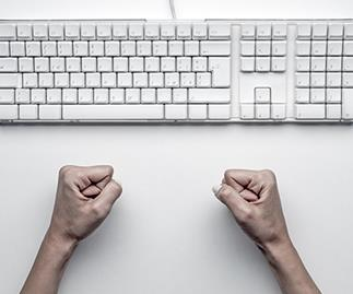 keyboard with closed fists, stock image.