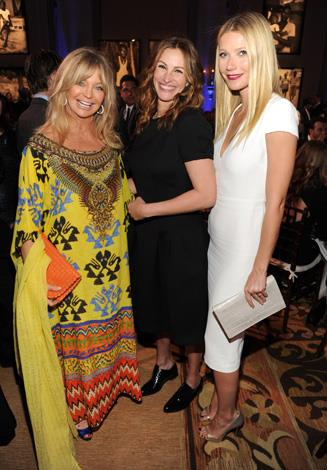 Before she made a name for herself Gywneth grew up the child of Hollywood parents mixing in famous circles from a young age. Here she is with Goldie Hawn and Julia Roberts at an event in January, 2014.