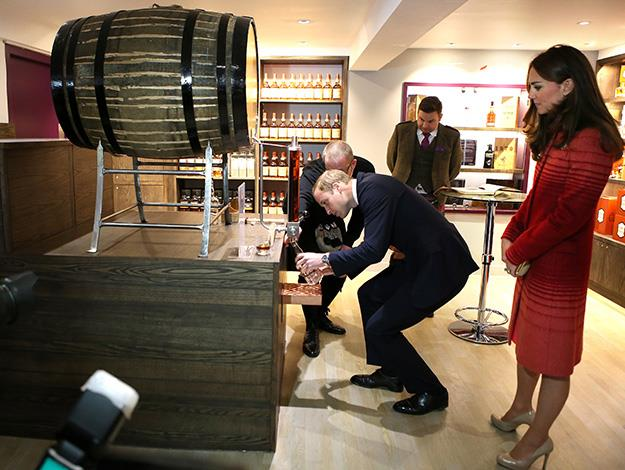 Prince William decants a bottle of Glenturret Single Malt whisky.