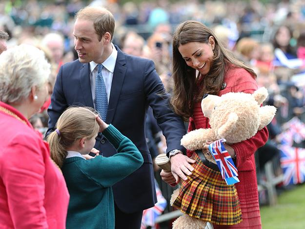 Kate accepts a gift for Prince George.