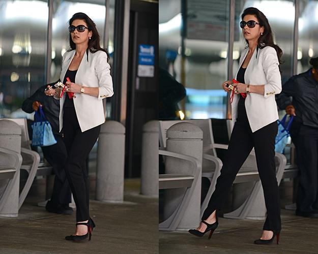 Catherine Zeta-Jones spotted lighting up on Monday outside an LA airport after getting off a flight from New York.