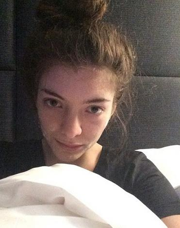 """Honest and down-to-earth Lorde wrote:""""In bed in paris with my acne cream on."""""""