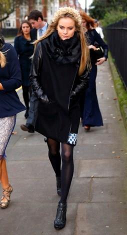 Cressida goes for an uber cool all black look at a friends wedding in December 2013.