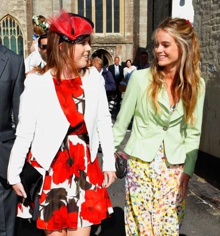 Bonas dressed in a covered up colourful floral ensemble with Eugenie in June 2013.