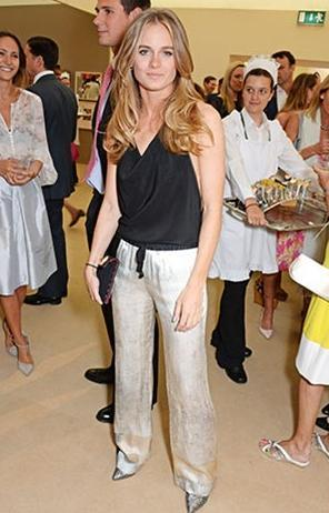 Cressida in a backless jumpsuit at the Art Antiques London Gala Evening in aid of Children in Crisis at Kensington Gardens.