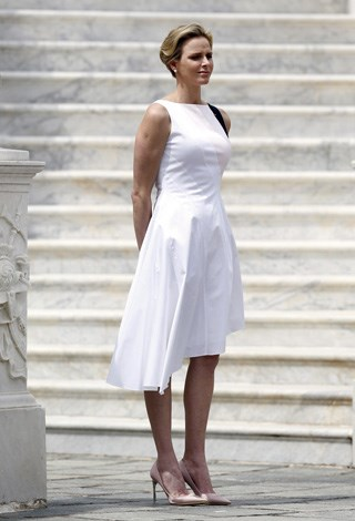 Princess Charlene of Monaco wears all white as she attends a welcoming ceremony held as part of Montenegro's president official visit to Monaco on May 6.