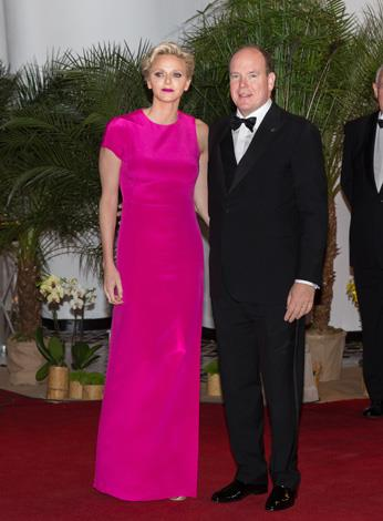 The royal looks youthful in this hot-pink number as she attends the F1 Grand Prix of Monaco Gala dinner on the arm of her husband, Prince Albert on May 25.