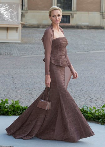 Charlene opts for this opulent chocolate outfit for the wedding of Princess Madeleine of Sweden and Christopher O'Neill in June 2013.