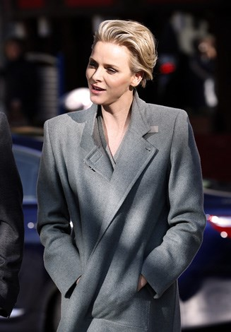The Princess fights off the chill in this chic well tailored coat as she walks the streets in Monaco.