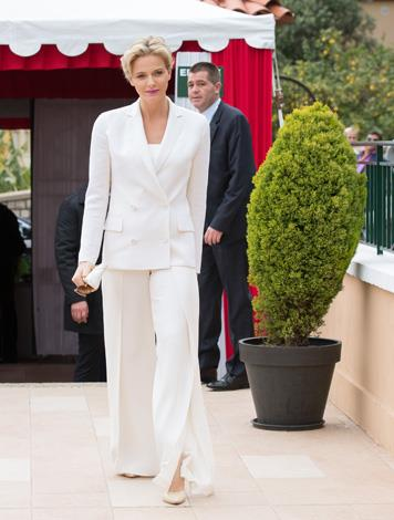 Charlene looks fantastic in this cream trouser-suit and heels for the tennis final on April 20.