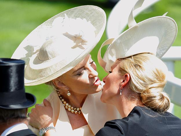 Zara Phillips and Princess Michael of Kent negotiate their ways around their hats to greet each other.