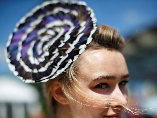 This gorgeous purple number must be borderline in the prohibition of fascinators.