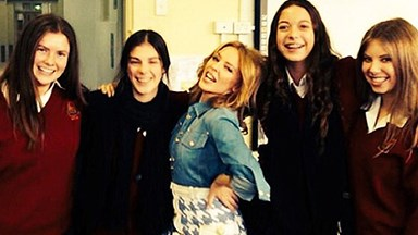 Kylie Minogue visits her old high school