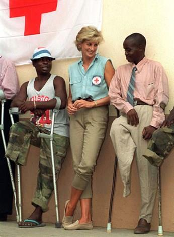 Diana doing charity work in Angola in 1997.