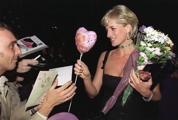 Diana receives gifts on her 36th birthday in 1997, shortly before her death.