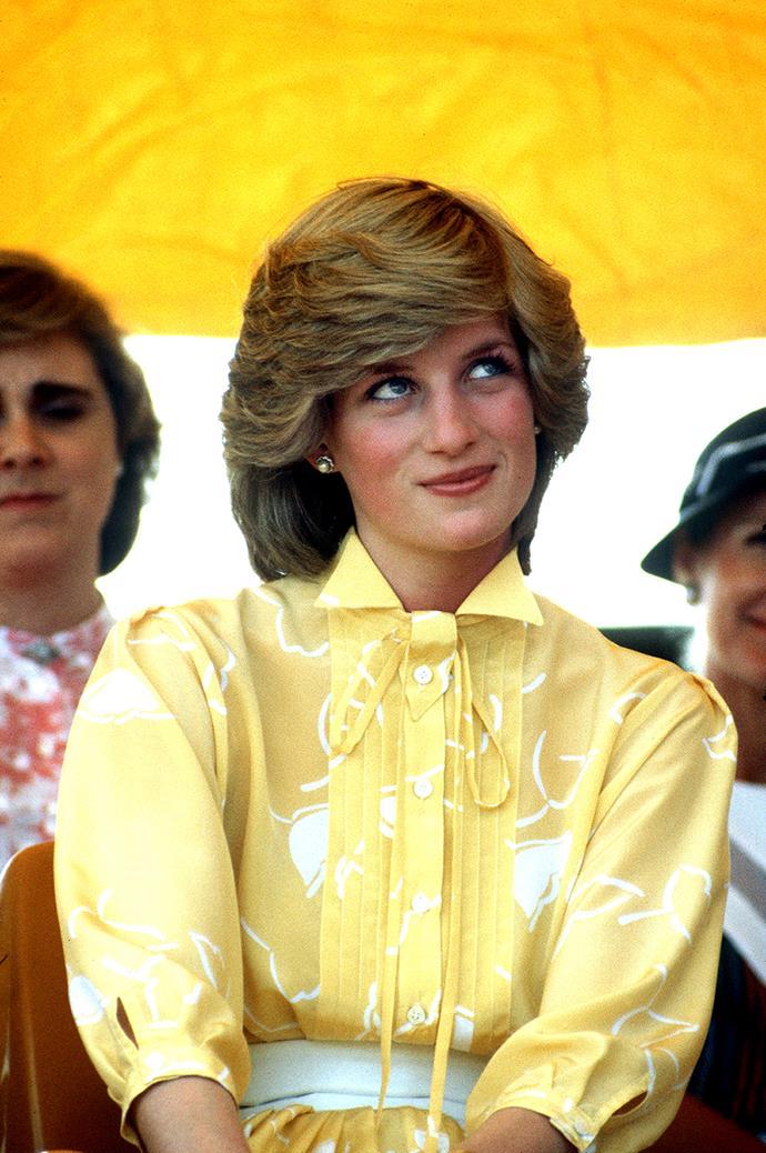 Princess Diana wearing a yellow dress by Jan van Velden in Alice Springs in 1983.