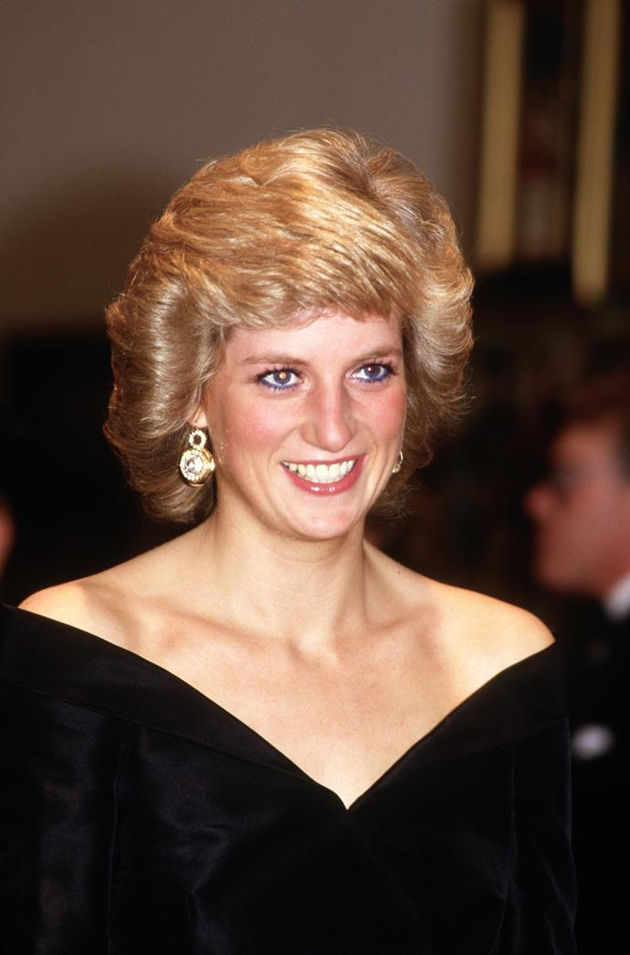 The Princess of Wales looked stunning in black at a fashion show at the Cologne Museum of Art in Cologne, Germany in November 1987.
