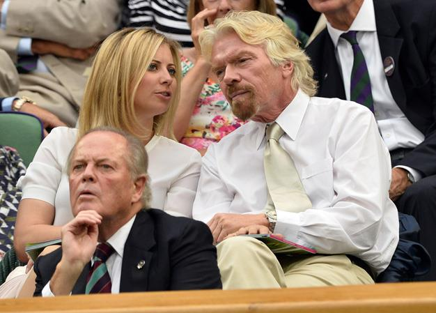Sir Richard Branson sat with his daughter Holly during the seventh day of the tennis tournament.