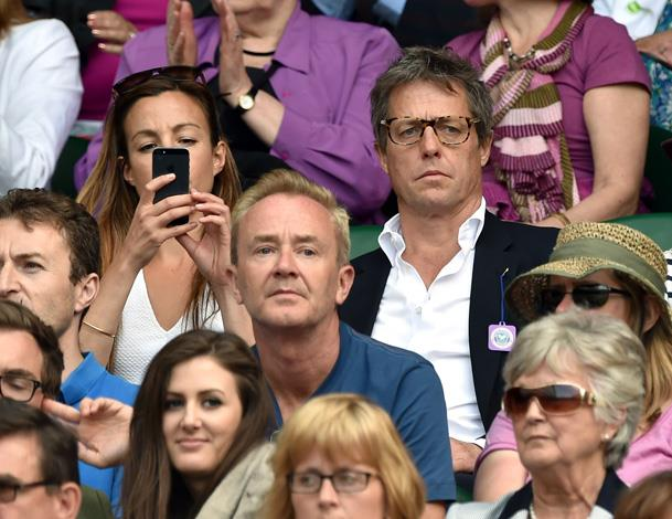 Thank goodness Hugh Grant found his glasses to attend the tennis. We would have hated to see him sporting a prescription scuba mask à la Notting Hill.