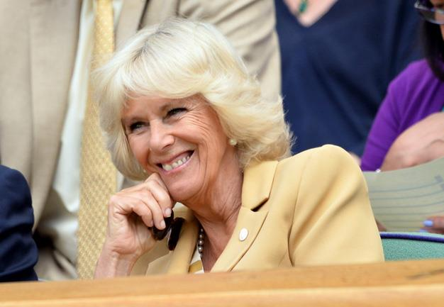 The Duchess of Cornwall attends the Casey Dellacqua v Agnieszka Radwanska match on centre court during day three of Wimbledon.