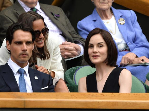 It gets very social in the stands: Pippa Middleton chats with Downton Abbey star Michelle Dockery during day four of the tournament.