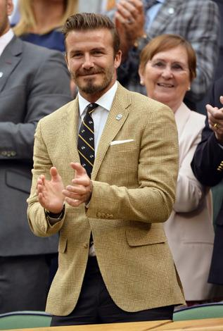 Unlike his old boss, Sir Alex Ferguson David Beckham looked pleased to be at the tennis.
