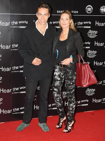 James, dressed in standard slone-style loafers, takes a friend to the Bryan Adams 'Hear The World Ambassadors' exhibition at Saatchi Gallery in 2009.
