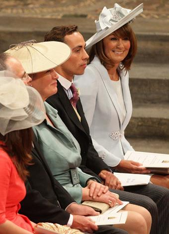 James sits with his mother Carole Middleton inside Westminster Abbey at the royal wedding.