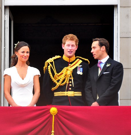 Pippa Middleton and James Middleton chat with their new brother-in-law Prince Harry on the balcony of Buckingham Palace after the nuptials.