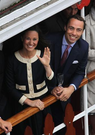 Pippa Middleton and James Middleton wave from the Spirit of Chartwell during the Diamond Jubilee Thames River Pageant in 2012.