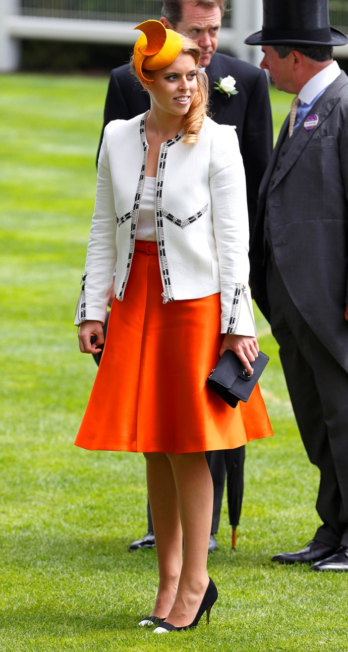 Princess Beatrice combined a tangerine skirt and headpiece for Ladies Day at Royal Ascot.