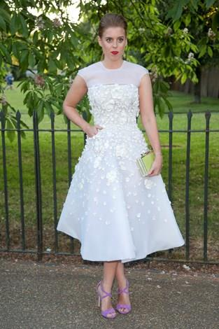 Princess Beatrice wore a white organza dress to the Serpentine Gallery Summer Party. She added pops of colour with purple pumps and bright red lippy.