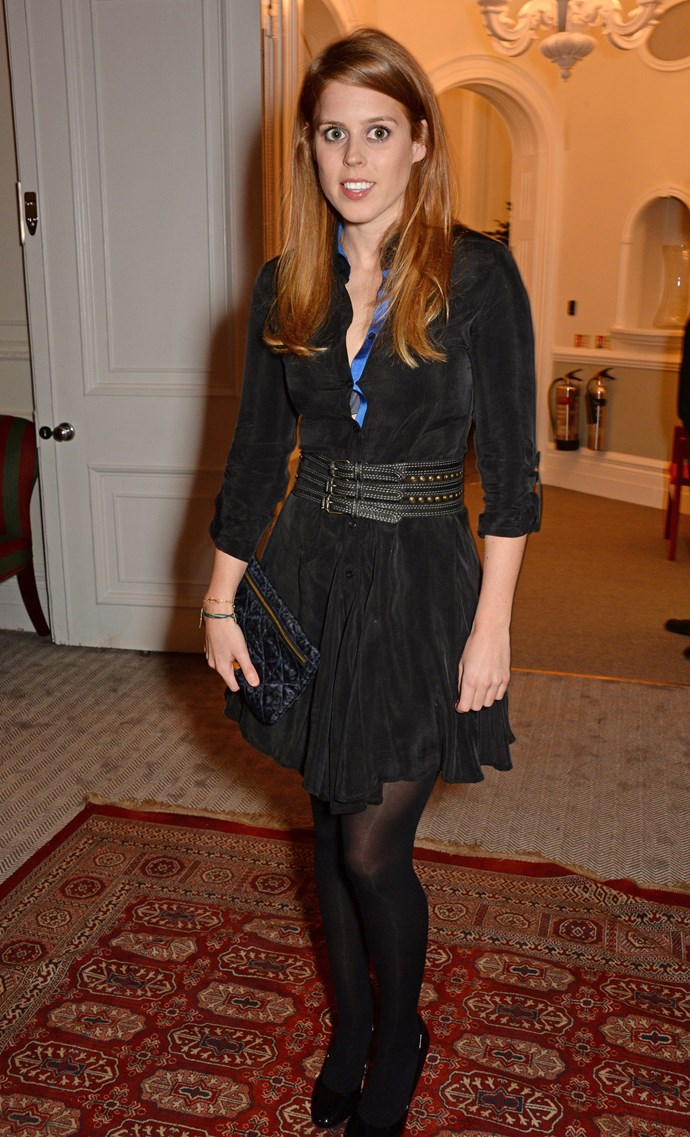 Princess Beatrice paired a long-sleeved black dress with stockings and a clutch for the Sabine G Harlequin Collection launch in April.