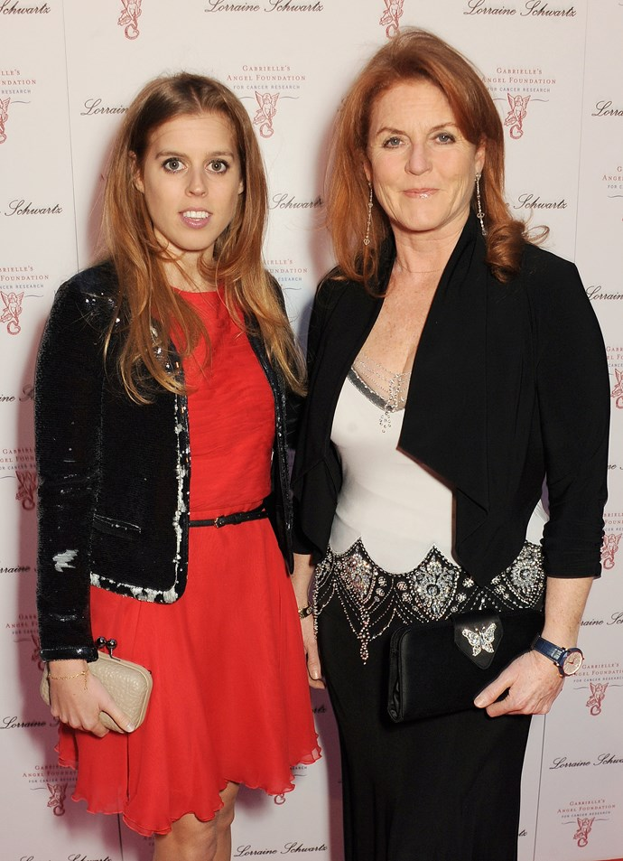 Princess Beatrice and her mother Sarah Ferguson, the Duchess of York, attend Gabrielle's Gala 2013. The young royal paired a red dress with a cropped black jacket and beige clutch.