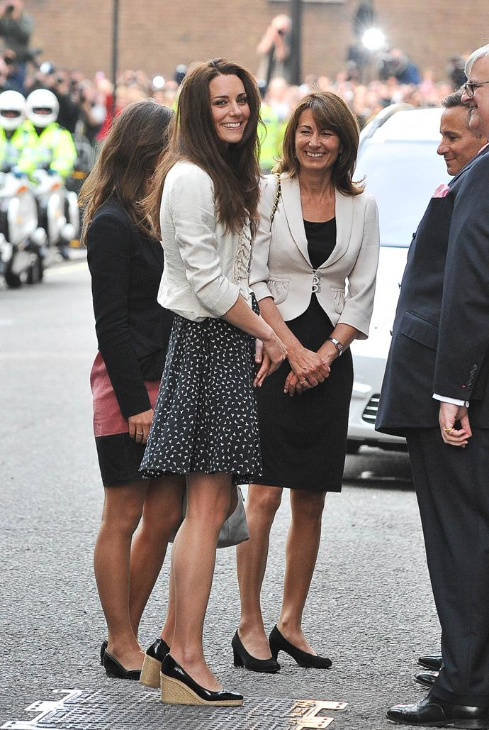 Kate and Carole paired a dress with a beige blazer and black heels during a visit to the Goring Hotel before the royal wedding.