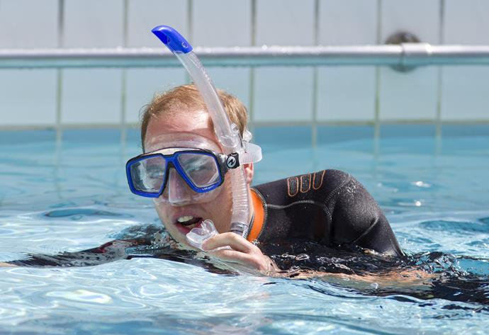 The Duke of Cambridge snorkels in the swimming pool.