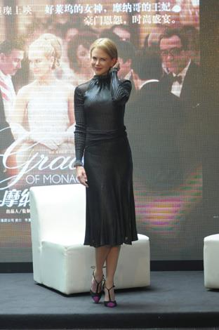 Nicole Kidman sports a high neck textured variation for the *Grace of Monaco* press conference in Shanghai in June.