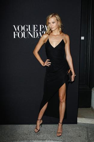 Karlie Kloss works a '90s inspired spaghetti strap gown.