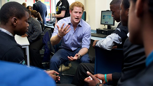 Prince Harry talks with students about the upcoming Invictus Games.