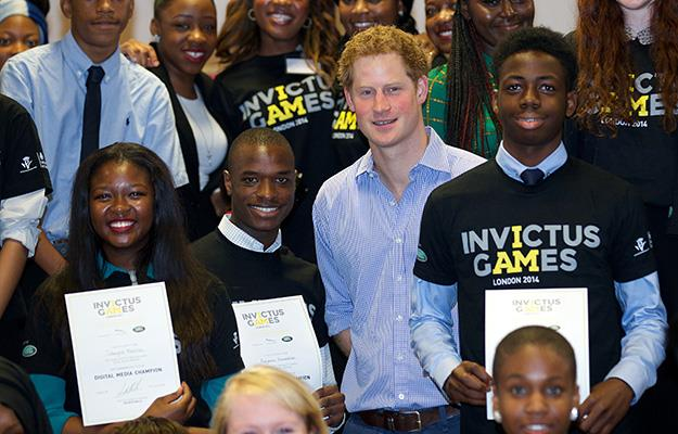 Prince Harry with students at the Bethnal Green Academy who have been appointed 'digital champions'.