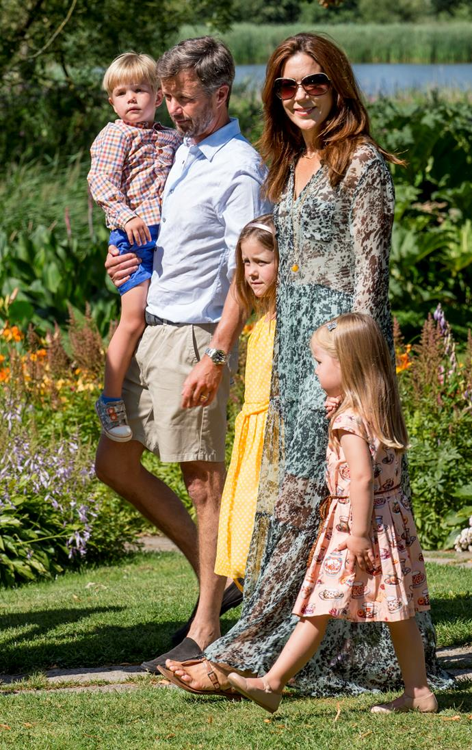 Mary and Frederik enjoy a stroll with their children.