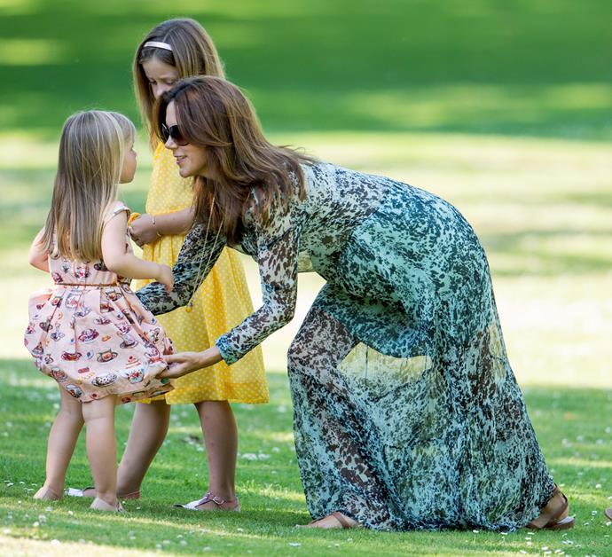 Princess Mary fixes Princess Josephine's dress.
