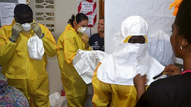 Staff from Samaritan's Purse put on protective in the ELWA hospital in Liberia.