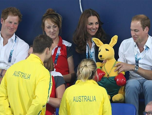 Two Aussie athletes present Kate, William and Harry with our famous boxing kangaroo.