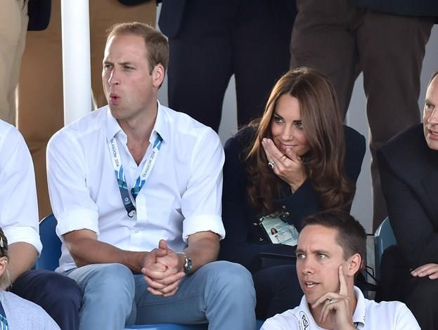 The eyes of the avid sports fans were firmly fixated on the game. Kate was captured wincing and blocking her face.