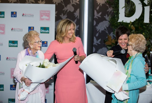 The Weekly's Helen McCabe and the High Tea's host Amanda Blair presented twins Peggy Ritchie and Betty Ireland with flowers to celebrate their 98th birthday.