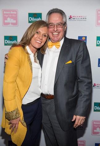 Associate Editor Caroline Overington and Max Grundmann smile for the camera.