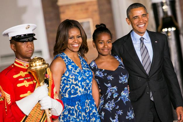 First lady Michelle Obama, daughter Sasha Obama and U.S. President Barack Obama attend the Marine Barracks Evening Parade on June 27, 2014 in Washington, DC.